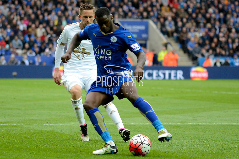 Swansea City midfielder Gylfi Sigurdsson holds up Leicester City forward Jeff Schlupp during the Barclays Premier League match between Leicester City and Swansea City at the King Power Stadium, Leicester, England on 24 April 2016. Photo by Alan Franklin.