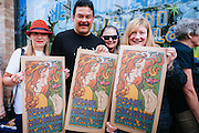 Bonnie Raitt fans waited outside Music Millennium in Portland, Oregon on April 16, 2016 (Record Store Day). Gary Houston designed a ltd. ed. hand pulled poster to commemorate the event.