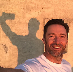 """Hugh Jackman releases a photo on Instagram with the following caption: """"You gotta admit - my selfie classes are really paying off! #priorities"""". Photo Credit: Instagram *** No USA Distribution *** For Editorial Use Only *** Not to be Published in Books or Photo Books ***  Please note: Fees charged by the agency are for the agency's services only, and do not, nor are they intended to, convey to the user any ownership of Copyright or License in the material. The agency does not claim any ownership including but not limited to Copyright or License in the attached material. By publishing this material you expressly agree to indemnify and to hold the agency and its directors, shareholders and employees harmless from any loss, claims, damages, demands, expenses (including legal fees), or any causes of action or allegation against the agency arising out of or connected in any way with publication of the material."""