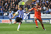 Sheffield Wednesday striker Fernando Forestieri (45) with the strike on goal during the Sky Bet Championship match between Sheffield Wednesday and Ipswich Town at Hillsborough, Sheffield, England on 16 April 2016. Photo by John Marfleet.