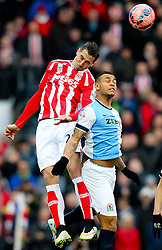 Stoke City's Geoff Cameron vhallenges Josh King of Blackburn Rovers  -  Photo mandatory by-line: Matt McNulty/JMP - Mobile: 07966 386802 - 14/02/2015 - SPORT - Football - Blackburn - Ewood Park - Blackburn Rovers v Stoke City - FA Cup - Fifth Round