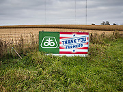 27 OCTOBER 2019 - POLK CITY, IOWA: A sign on the edge of a partially harvested corn field near Polk City, Iowa. Iowa farmers have been weeks behind schedule through most of the 2019 growing season. A cold, wet spring across most of the state delayed planting by about 2 weeks. A historically wet October has pushed the harvest of soybeans and corn back by up to 3 weeks. Central Iowa normally gets about 2.6 inches of rain in October, this year central Iowa has received about 7.3 inches of rain. This year has been the wettest year on record in Iowa. Farmers have also been contending with low prices, brought on by trade war between the US and China. The Chinese government imposed retaliatory tariffs on US agricultural products and cancelled orders of corn, soybeans, and pork, all important Iowa agricultural products. Soybean prices have fallen by as much as 20%.            PHOTO BY JACK KURTZ