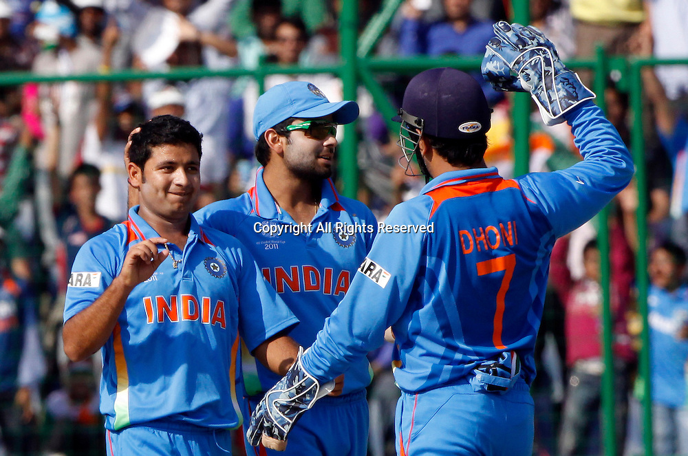 09.03.2011 Cricket World Cup from the Feroz Shah Kotla stadium in Delhi. India v Netherlands. Piyush Chawla of India celebrates the wicket of Eric Szwarczynski during the match of the ICC Cricket World Cup between India and Netherlands