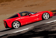 Image of a red Corvette sports car on track at Pacific Raceways, Auburn, Washington, Pacific Northwest
