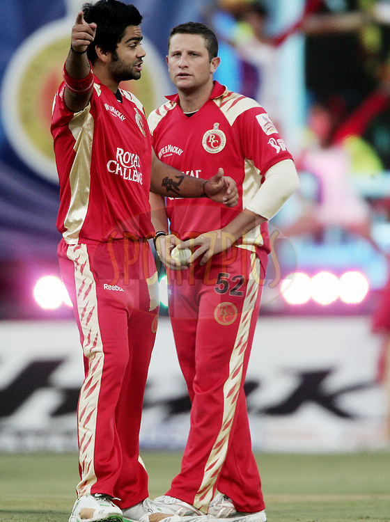 JOHANNESBURG, SOUTH AFRICA - 23 May 2009. Virat Kohli and Roelof van der Merwe during the  IPL Season 2 second Semi Final match between the Chennai Superkings and the Royal Challengers Bangalore held at The Wanderers Stadium in Johannesburg, South Africa..