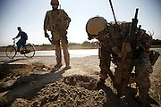 A german pioneer platoon is off OP North to check culverts around to make sure safety bars are still fixed to avoid IED planting beneath the street.