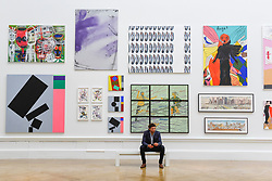&copy; Licensed to London News Pictures. 08/06/2017. London, UK. A visitor sits in front of works on display. Preview of the Summer Exhibition 2017 at the Royal Academy of Arts in Piccadilly.  Co-ordinated by Royal Academician Eileen Cooper, the 249th Summer Exhibition is the world's largest open submission exhibition with around 1,100 works on display by high profile and up and coming artists.<br />  Photo credit : Stephen Chung/LNP
