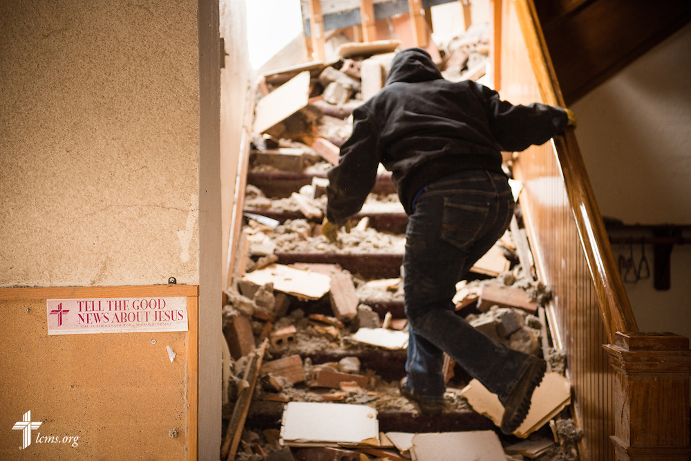 A church member ascends a stairwell at Zion Lutheran Church on Monday, May 11, 2015, in Delmont, S.D. A tornado swept through the area the previous day and destroyed the church and nearby buildings. LCMS Communications/Erik M. Lunsford