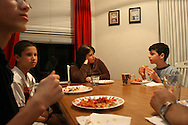 Sandy Pulliam (center) asks her son Cody  about his school day during dinner at their Westchase home. Cody, who has Aspergers,  tried several schools before settling in at Quest Middle School.  At left are his stepbrothers Andrew Pulliam, 14, far left, and Austin Pulliam, 13, second from left.