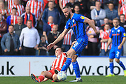 Aaron Wilbraham is challenged during the EFL Sky Bet League 1 match between Rochdale and Sunderland at Spotland, Rochdale, England on 6 April 2019.