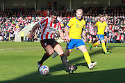 Dan Holman and Bradley Wood during the Vanarama National League match between Cheltenham Town and Lincoln City at Whaddon Road, Cheltenham, England on 30 April 2016. Photo by Antony Thompson.