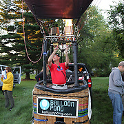 Nick Donner, USA, (second right) and his crew prepare to launch around rural Michigan near Battle Creek during competition in the 20th FAI World Hot Air Ballooning Championships. Battle Creek, Michigan, USA. 23rd August 2012. Photo Tim Clayton