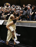 Purdue Boilermakers center A.J. Hammons gives teammate Rapheal Davis a ride on his back around fans after defeating Indiana. Purdue hosted Indiana at Mackey Arena Wednesday, January 28, 2015.
