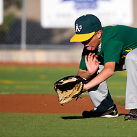 060313     B rian Leddy <br /> Athletics second baseman Trevor Rainey fields a ground ball during Monday nights game against the Orioles at Ford Canyon Park.