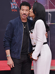 (L-R) Lionel Richie and Lisa Parigi at the Lionel Richie Hand and Footprint Ceremony held at the TCL Chinese Theatre in Hollywood, CA  on Wednesday, March 7, 2018. (Photo By Sthanlee B. Mirador/Sipa USA)