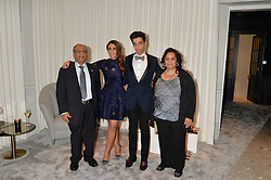 CRISIAN MONAGAS and REGINA MONAGAS with their parents at the Crisian London Boutique Opening at 41-42 Dover Street, London on 18th November 2014.