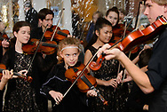 Music City Strings perform a medley of fiddle tunes as guests mingle under the tent at The Heritage Foundation 50th anniversary celebration outside the Franklin Theater in Franklin, Tenn. on Nov. 12, 2017.