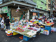 01 DECEMBER 2016 0 BANGKOK, THAILAND: The traditional market on Lan Luang Road in Bangkok. The market is on the site of one of the first western style cinemas in Bangkok. The movie theatre closed years ago and is still empty but the market fills the streets around the theatre.     PHOTO BY JACK KURTZ