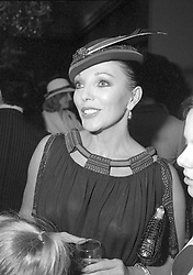 JOAN COLLINS at a Charity Auction in aid of Save The Children at Sotheby's New Bond Street London on 18th June 1979.