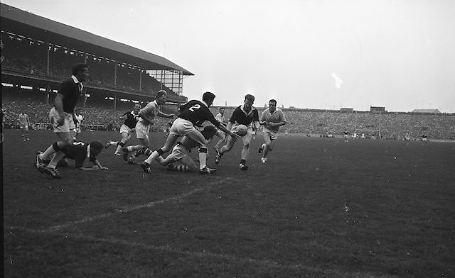 Galway's Colleran and McDonagh keep the ball safe as Dublin forwards players Ferguson and Timmons advance during the All Ireland Senior Gaelic Football Championship Final Dublin v Galway in Croke Park on the 22nd September 1963. Dublin 1-9 Galway 0-10.
