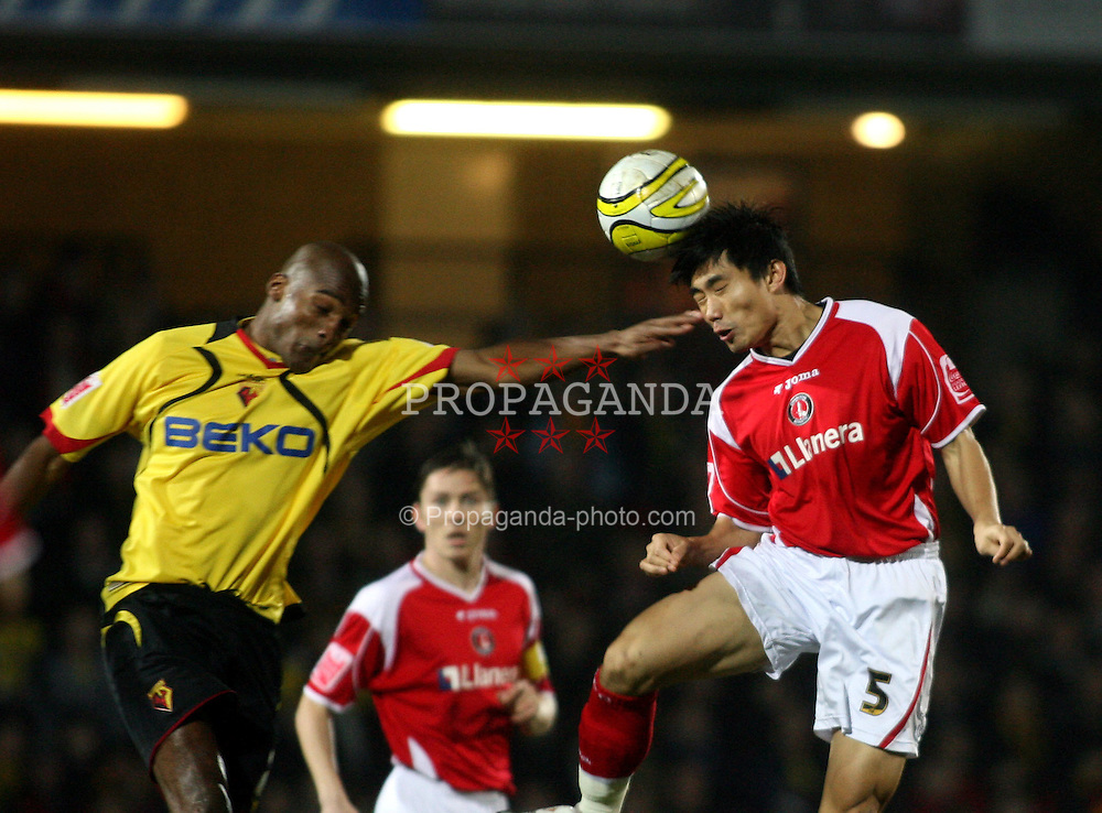 WATFORD, ENGLAND - Saturday, January 19, 2008: Charlton Athletic's Zheng Zhi and Watford's Damien Francis during the League Championship match at Vicarage Road. (Photo by Chris Ratcliffe/Propaganda)