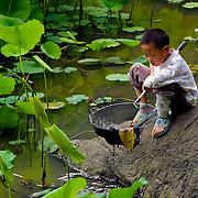 Boy fishing II, Yangshuo, China (May 2004)