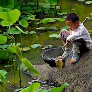 Boy fishing II, Yangshuo, China (May 2004)