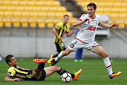 Adelaide United's Isaías, right, lunges past the outstretched leg of the Phoenix's Andrija Kaluderovic in the A-League football match at Westpac Stadium, Wellington, New Zealand, Sunday, October 08, 2017. Credit:SNPA / Dean Pemberton **NO ARCHIVING**