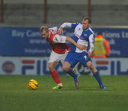 Bristol Rovers' David Clarkson challenges Morecambe's Robbie Threlfall - Photo mandatory by-line: Dougie Allward/JMP - Tel: Mobile: 07966 386802 14/12/2013 - SPORT - Football - Morecombe - Globe Arena - Morecombe v Bristol Rovers - Sky Bet League Two