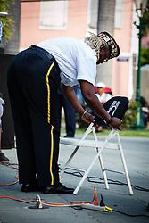 Comrade Irma George places the POW/MIA remembrance honor.  Veteran's Day Parade and Program at the Frankliin Delano Roosevelt Memorial Park in Charlotte Amalie.  St. Thomas.  11 November 2013.  © Aisha-Zakiya Boyd