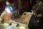 Mlada Boleslav/Tschechische Republik, Tschechien, CZE, 16.03.07: Mitarbeiter beim Schweißen von Karosserieteilen eines Skoda Octavia in der Skoda Auto Fabrik in Mlada Boleslav. Der tschechische Autohersteller Skoda ist ein Tochterunternehmen der Volkswagen Gruppe. <br /> <br /> Mlada Boleslav/Czech Republic, CZE, 16.03.07: Workers at the Skoda factory welding on Octavia assembly line at Skoda car factory in Mlada Boleslav. Czech car producer Skoda Auto is a subsidiary of the German Volkswagen Group (VAG).