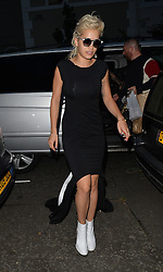 Singer Rita Ora dressed in monochrome leaves a studio and picks up a Caribbean takaway before heading home with boyfriend Richard Hilfiger. London, UK. 05/09/2014<br />BYLINE MUST READ : GOTCHAIMAGES.COM<br /><br />Copyright by © Gotcha Images Ltd. All rights reserved.<br />Usage of this image is conditional upon the acceptance <br />of Gotcha Images Ltd, terms and conditions available at<br />www.gotchaimages.com