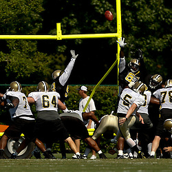 August 1, 2010; Metairie, LA, USA; New Orleans Saints kicker Garrett Hartley (5) practices field goals during a training camp practice at the New Orleans Saints practice facility. Mandatory Credit: Derick E. Hingle