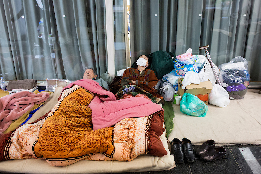 KUMAMOTO, JAPAN - APRIL 21: Earthquake survivors take a shelter in the morning of April 21, 2016 in Mashiki Gymnasium evacuation center, Kumamoto, Japan. To date 45 people are confirmed dead and around 11,000 people have evacuated after an 6.5 earthquake on Thursday night and a stronger 7.3 quake on Saturday morning struck the Kyushu Island in western Japan.<br /> <br /> Photo: Richard Atrero de Guzman