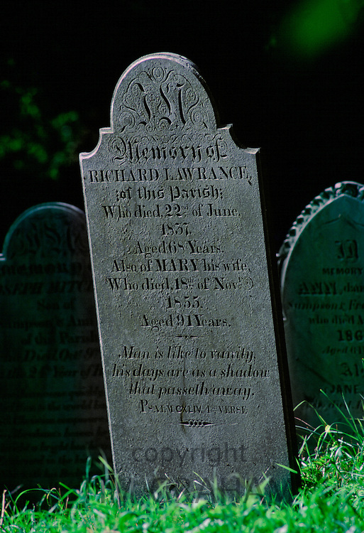 Gravestone aged with lichens in the churchyard graveyard at Landewednack, Cornwall, England, United Kingdom
