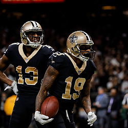 Nov 5, 2017; New Orleans, LA, USA; New Orleans Saints wide receiver Ted Ginn Jr. (19) celebrates with wide receiver Michael Thomas (13) after a touchdown against the Tampa Bay Buccaneers during the second half of a game at the Mercedes-Benz Superdome. The Saints defeated the Buccaneers 30-10. Mandatory Credit: Derick E. Hingle-USA TODAY Sports