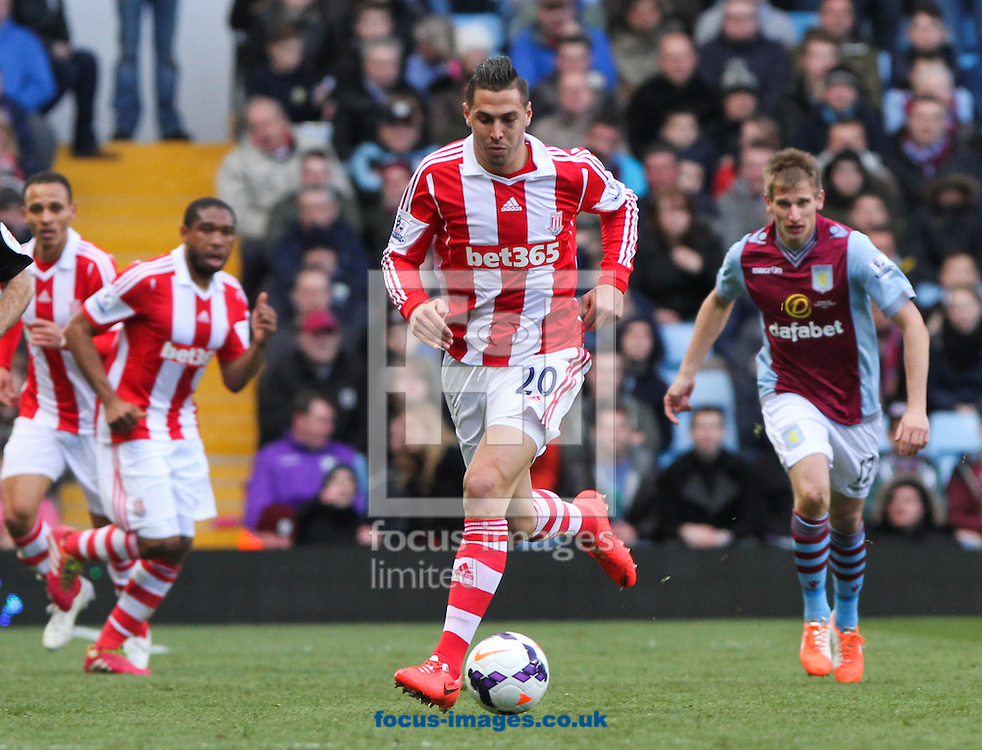 Geoff Cameron (centre) of Stoke City in possession of the ball during the Barclays Premier League match at Villa Park, Birmingham<br /> Picture by Tom Smith/Focus Images Ltd 07545141164<br /> 23/03/2014