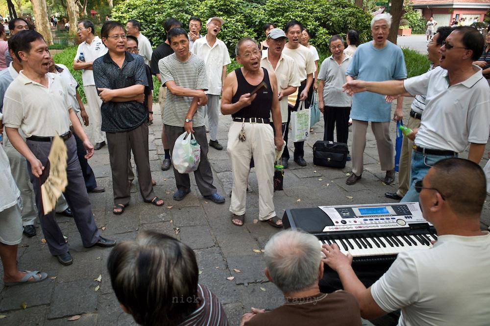 Singing patriotic songs in Lu Xun Park, Shanghai, China.