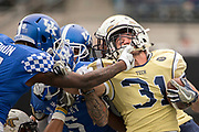Georgia Tech running back Nate Cottrell, right, is tackled by Kentucky cornerback J.D. Harmon (11) on a kick return during the second half of the TaxSlayer Bowl NCAA college football game, Saturday, Dec. 31, 2016, in Jacksonville, Fla. Georgia Tech beat Kentucky 33-18. (AP Photo/Stephen B. Morton)