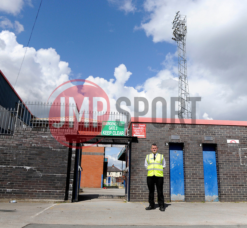A steward operates Gate 2 at Rochdale, Spotland Stadium - Photo mandatory by-line: Dougie Allward/JMP - Mobile: 07966 386802 23/08/2014 - SPORT - FOOTBALL - Manchester - Spotland Stadium - Rochdale AFC v Bristol City - Sky Bet League One