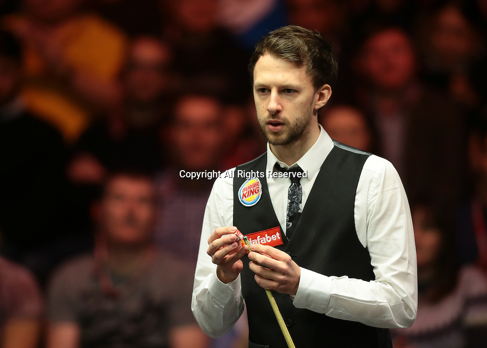 16.01.2016.  Alexandra Palace, London, England. Masters Snooker. Semi Finals. Judd Trump chalks his cue and prepares to break off at the start of the Semi Final against Barry Hawkins