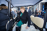 Norwegian Prime Minister Erna Solberg catching a ride in a golf cart on her way to more meetings on day two of the World Economic Forum in Davos.