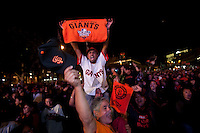 SAN FRANCISCO, CA - NOV 1:  Fans react after watching the Giants defeat the Texas Rangers to win the World Series in 5 games at the Civic Center Plaza on November 1, 2010 in San Francisco, California.  The Giants won their first World Series in 56 years since moving to San Francisco from New York.  Photograph by David Paul Morris