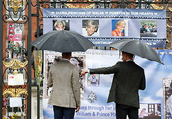 The Duke of Cambridge and Prince Harry look at tributes to Diana, Princess of Wales attached to the Golden Gates of Kensington Palace, London, ahead of the 20th anniversary of their mother's death.