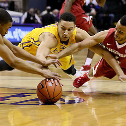 Jan 16, 2016; Baton Rouge, LA, USA; Arkansas Razorbacks forward Keaton Miles (55) and guard Jabril Durham (4) scramble for a loose ball with LSU Tigers forward Ben Simmons (25) during the first half of a game at the Pete Maravich Assembly Center. Mandatory Credit: Derick E. Hingle-USA TODAY Sports