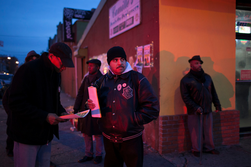 Jose LaSalle, center, with fliers, speaks with Carlos Oplacio, left, as he hands out fliers at a memorial for Kimani Gray at E 55 St and Church Ave in Brooklyn, NY on Sunday, March 17, 2013...Photograph by Andrew Hinderaker