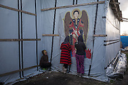 Women assisting to a orthodox mass in the local church. Migrants camp, Calais, France. FEDERICO SCOPPA/CAPTA