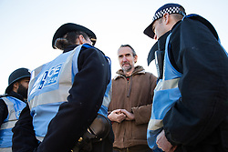 London, UK. 17th November, 2018. Police officers speak to climate activist Roger Hallam as environmental campaigners from Extinction Rebellion block Lambeth Bridge, one of five bridges blocked in central London, as part of a Rebellion Day event to highlight 'criminal inaction in the face of climate change catastrophe and ecological collapse' by the UK Government as part of a programme of civil disobedience during which scores of campaigners have been arrested.