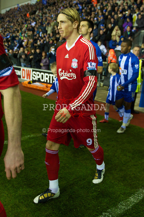 WIGAN, ENGLAND - Monday, March 8, 2010: Liverpool's Fernando Torres walks out to face Wigan Athletic during the Premiership match at the DW Stadium. (Photo by David Rawcliffe/Propaganda)