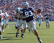 Kansas State's Daniel Gonzalez (83) picks up the blocked punt and runs it back 21-yards for a touchdown against Oklahoma State, at Bill Snyder Family Stadium in Manhattan, Kansas, October 7, 2006.  The Wildcats beat the Cowboys 31-27.<br />